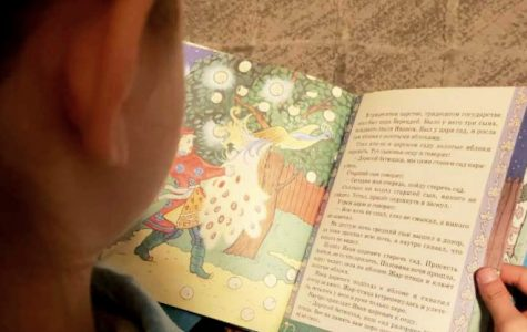 Improving fluency. BHS Junior Elsie Marchuk reads a children's book in Ukrainian, her parents' first language. A couple of years ago, Marchuk renewed her attempt to learn the language using books and Duolingo, an app that is used by many BHS students who are learning a language not offered through the school system.