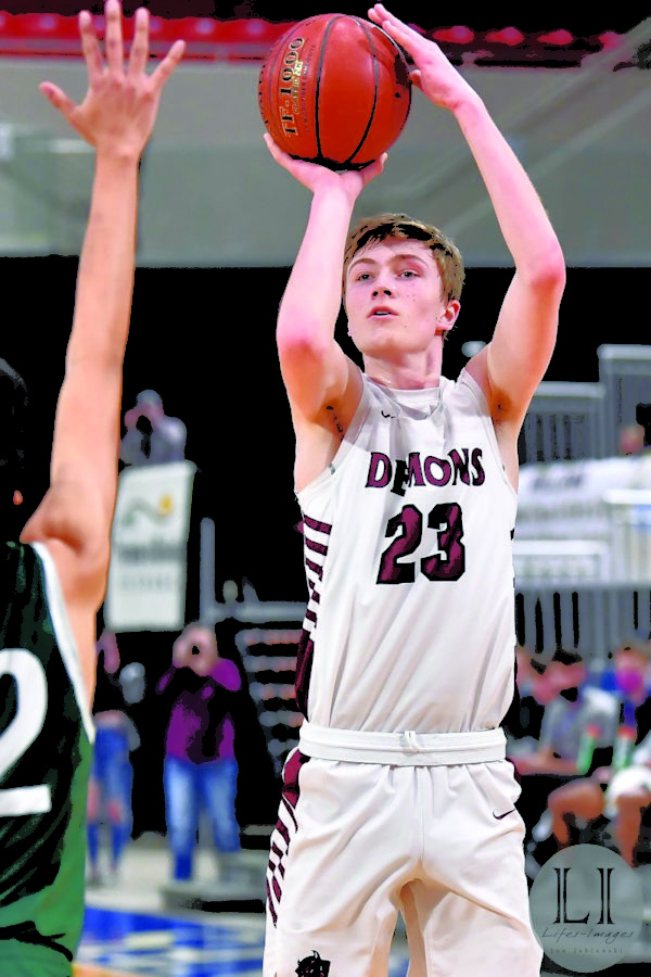 """Shooting. Senior Gunner Swanson shoots a three pointer during a state tournament game in early March. Swanson learned many lessons during his career that will carry him throughout his career. """"BHS has taught me how to work hard, be resilient and to be an overall better person on and off the court,"""" Swanson said."""